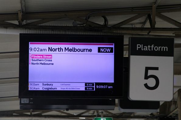 North Melbourne train in purple on the screens at Flinders Street