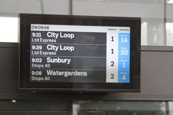 Next train departure board on the concourse at Ginifer station