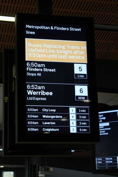 'Buses replacing trains on Upfield line tonight' message replaces the next Upfield line departure on the PIDS at North Melbourne station