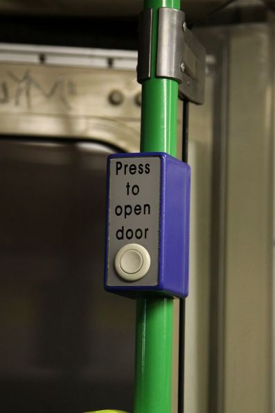 'Press to open door' text on the next stop button for the rear door of Z3.200