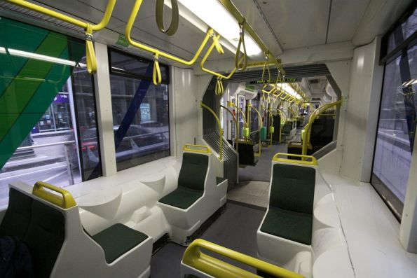 Single seats above the bogies in the cab section of a D2 class Combino tram