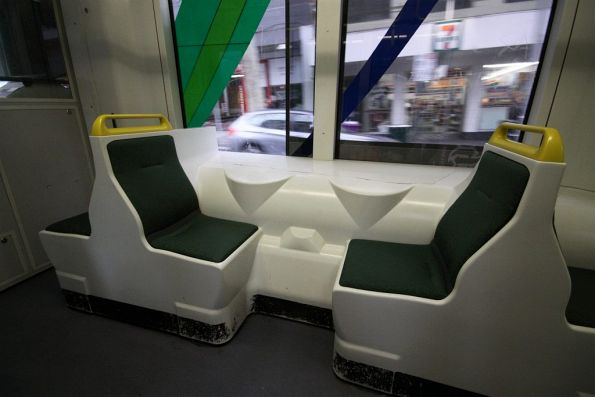 Dinky little single seats above the bogies in a Combino tram