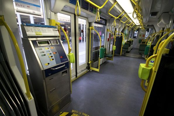 Intermediate section of a D2 class Combino tram: the one with four doors and the Metcard ticket machine