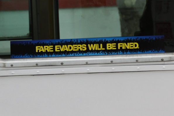 New fare evasion campaign window stickers: 'Fare evaders will be fined.'