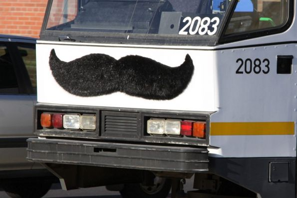 Movember mo' on the front of B2.2083