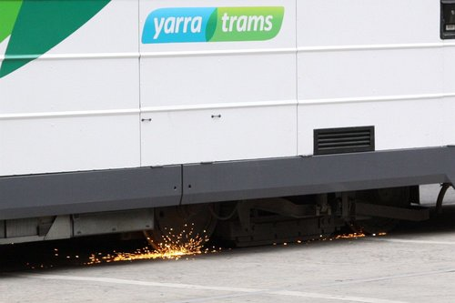 Arcing between the wheels and rails of a Z3 class tram on William Street