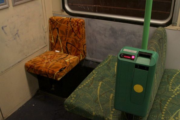 Orange coloured priority seat behind the cab of a B2 class tram