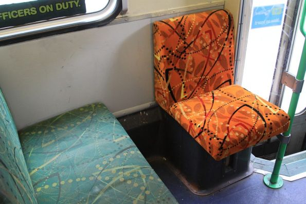 Retrofitted orange cover on the priority seat of B2.2036