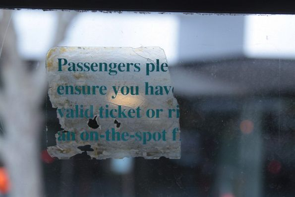 PTC-era 'please ensure you have a valid ticket' sticker onboard a tram