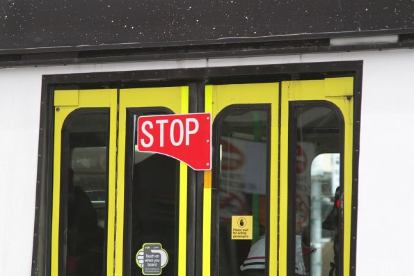 New style 'STOP' flag on the doors of a Z3 class tram