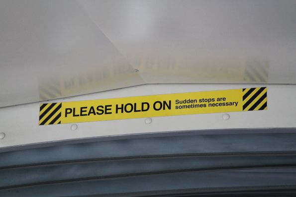 'Please hold on. Sudden stops are sometimes necessary' sticker onboard a C class tram