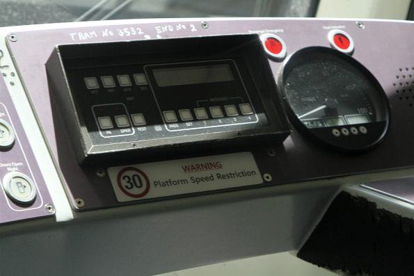'Warning: 30 km/h platform speed restriction' notice on the dashboard of a D1 class tram