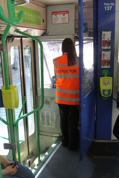 Instructor accompanies a tram driver in training