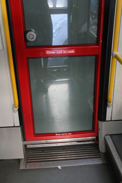 'Door not in use' notice on the right hand side saloon door of a C2 class tram, located immediately behind the cab