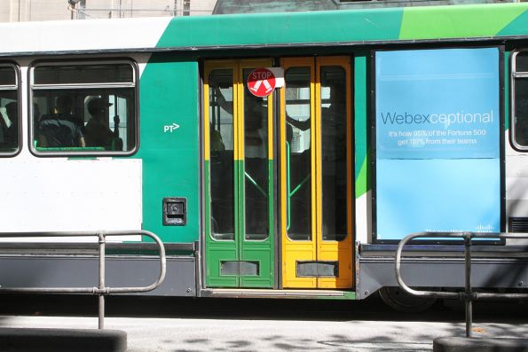 Green and yellow liveried 'The Met' door fitted to tram B2.2014