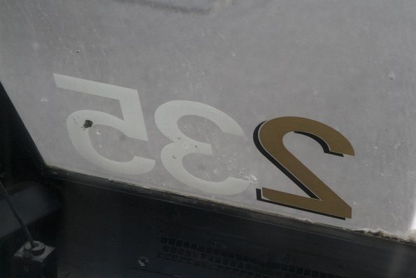 Gold W class styled '2' digit at one end of A1.235