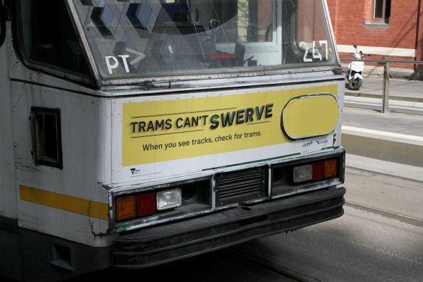 'Trams Can't Swerve' campaign poster on the end of a tram