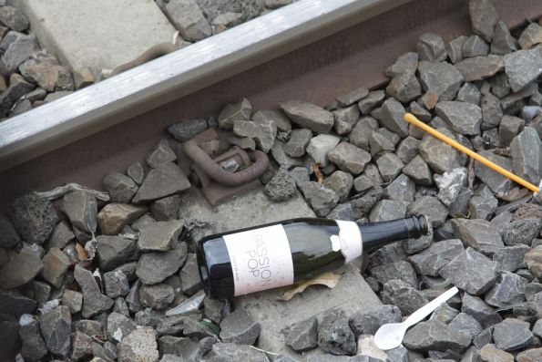 Bottle of Passion Pop on the tracks