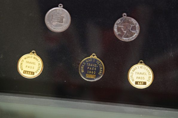 Various medallions that entitled the bearer to free public transport