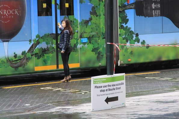 Passenger at Lonsdale Street oblivious to the 'tram stop closed' sign