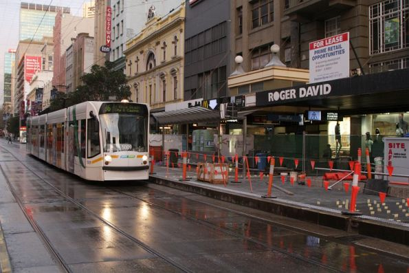 D2.5009 on route 96 passes almost complete platform stop works at the west end of the Bourke Street Mall
