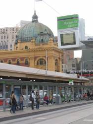 Tram stop outside Flinders Street Station on Swanston Street