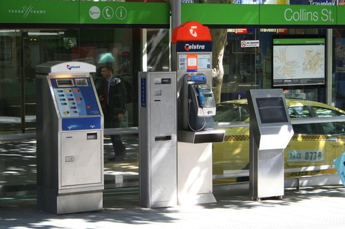 Metcard machine, change machine, Telstra payphone and SmartGuide journey planner at the Town Hall superstop