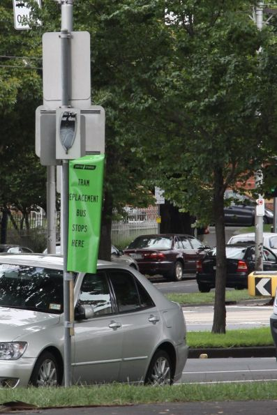 'Tram replacement bus stops here' flag on Flemington Road