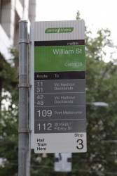 Tram stop on Collins Street at William Street: six different route numbers