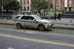 A police car squeezes through the new Melbourne Central tram stop
