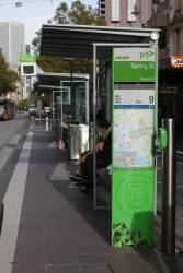'PTV' branded tram stop totem, with the Metro Trains fractal design on the bottom