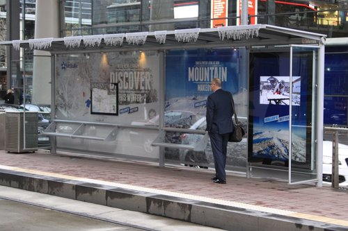 Tram stop covered in advertising for Mount Buller