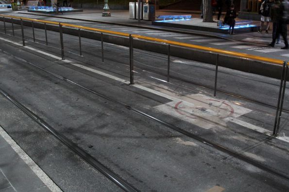 Permanent fencing in place between the tracks at the Melbourne Central tram stop on Swanston Street