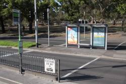 Safety zone tram stop on Flemington Road, with the tram shelter in the median strip