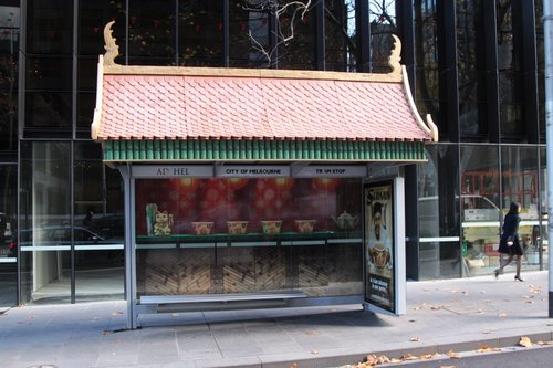 Asian style roof attached to an AdShel tram shelter on William Street, advertising Suimin noodles