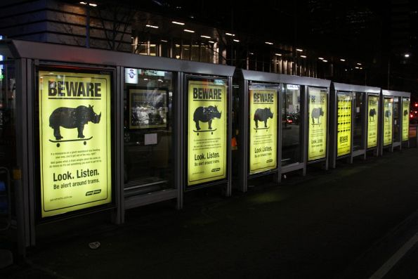 Row of 'Beware The Rhino' posters on the Elizabeth Street stop at La Trobe