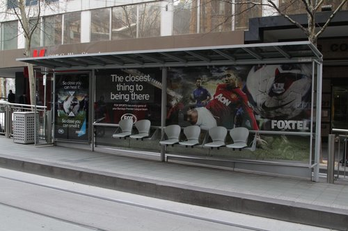 Foxtel advertising on Collins Street at the Town Hall tram stop