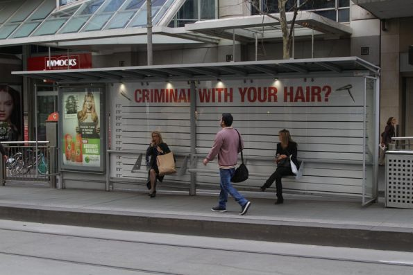 Ad wrapped tram stop at Collins Street advertising Garnier hair products