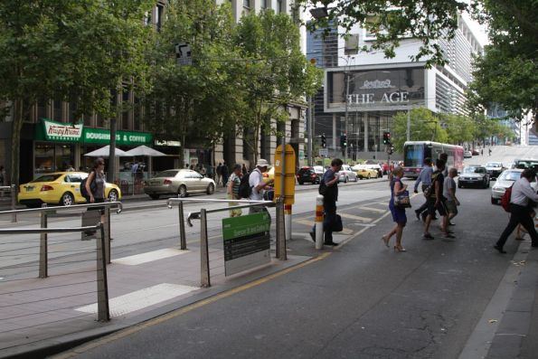 Pedestrians take the shortest route from the Spencer and Collins Street tram stop towards Southern Cross