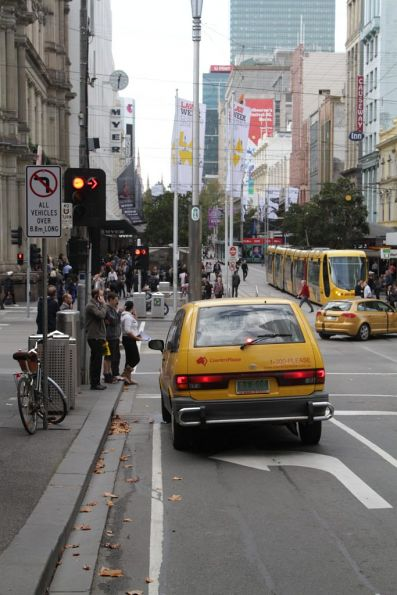'No left turn all vehicles over 8.8m long' sign at the corner of Bourke and Elizabeth Streets