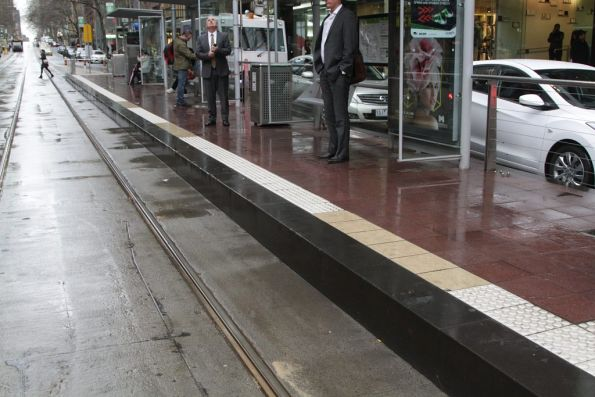 Original Collins Street platform stop surfaces - red paving and bluestone face, and tactile paving that lined up with the C class trams