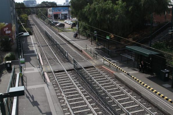 Pedestrian level crossing splits the platforms in half at the South Melbourne light rail stop on route 96