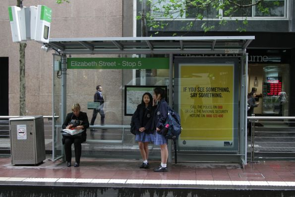 'If you see something, say something' scaremongering on a tram stop at Collins and Elizabeth Streets