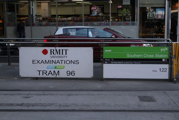 'RMIT examinations route 96' sign outside Southern Cross Station