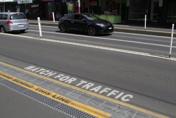 'Watch for traffic' notice at the new 'drive over' tram stops on Bridge Road, Richmond