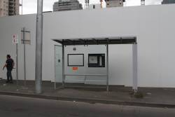 AdShel tram stop shelter, located on the footpath opposite the safety zone