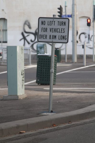 'No left turn for vehicles over 8.8m long' sign at the new Elgin and Lygon Street tram stop