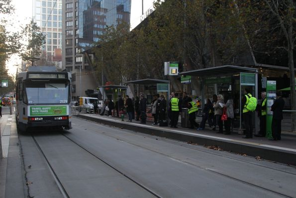 Temporary staff from Hoban recruitment count tram passengers on Collins Street