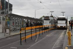 New plastic fence between the tracks at the Federation Square tram stop