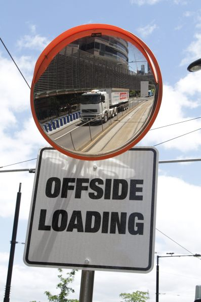 'Offside loading' sign at the Collins Landing platform stop on Collins Street